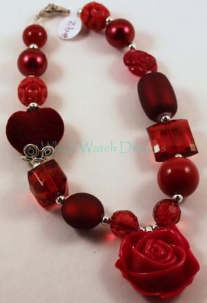 Love necklace featuring a large red resin rose and all red beads including a lovely flocked heart bead. Clip this necklace enhancer onto any chunky chain for a fun, trendy necklace, then switch it our for a new look anytime!