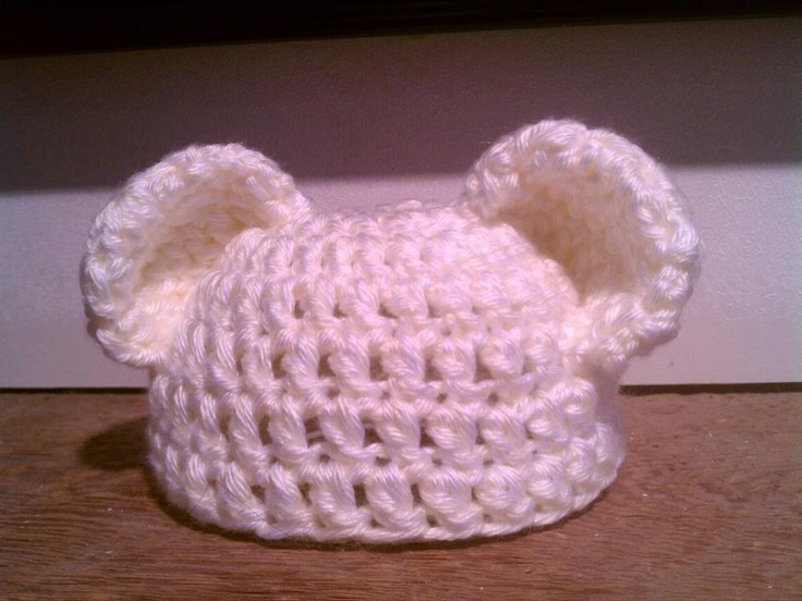 Teddy bear baby hat ..straightforward baby hat pattern but modified ears. Crochet tubes, flatten and form into bear ears, pin in place and sew to affix to the hat.  Easy peasy!!!