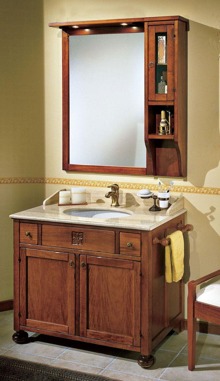 """Maße:   100 x 61 x 205 cm Farbe:   Walnuss  Ein schmales, nur ein Meter breites Badmöbel aus der """"Ricordi"""" Kollektion, komplett mit Spiegel, Spotlights, einem kleinen Schränkchen und einer Basis mit zwei Türen und zwei niedlichen kleinen Schubladen."""