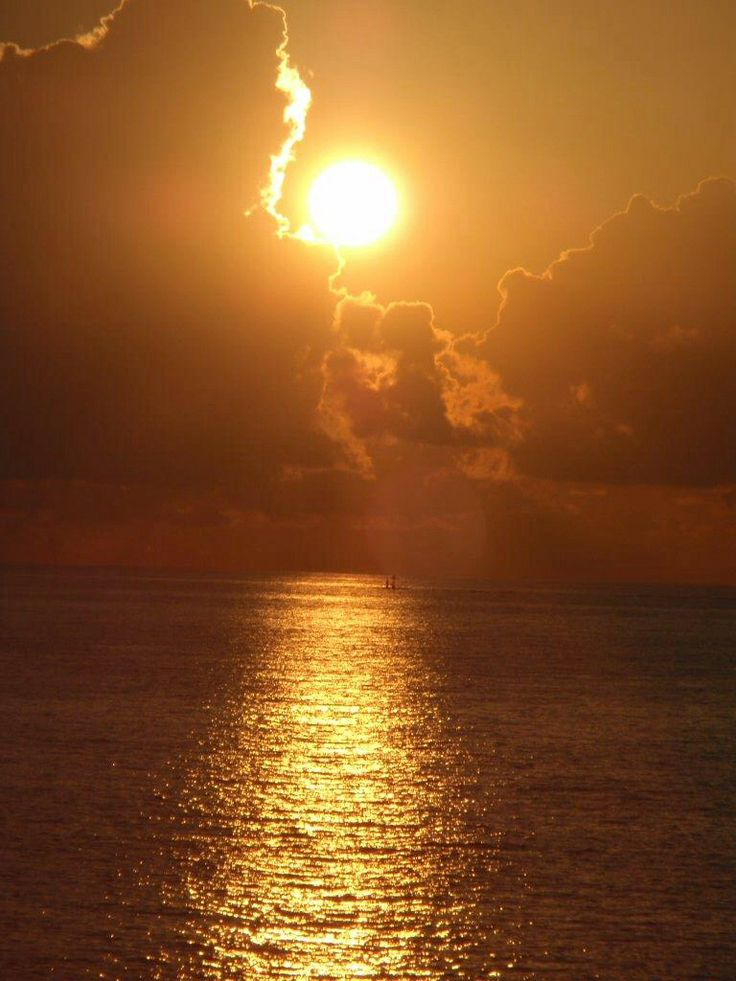 Summer sunset over Isla Mujeres, Mexico-  photo by Cedes Buck