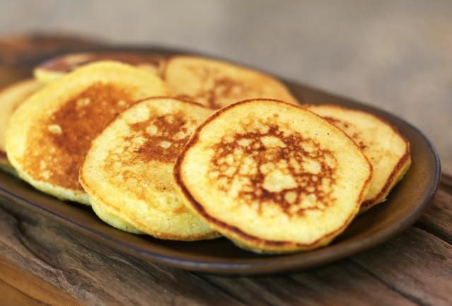 These johnnycakes are similar to cornmeal pancakes. The flat cakes are lightly sweetened and served with syrup, or serve them as a savory bread.