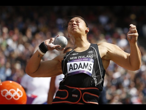 New Zealand's Valerie Adams takes a throw in a women's shot put qualification round