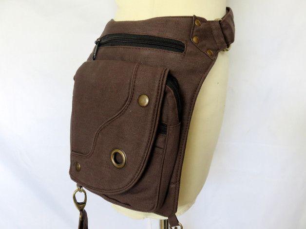 Dieser Taschen-Hüftgürtel aus Baumwolle ist verstellbar von 84 - 120 cm Er verfügt über 4 Reißverschlusstaschen Vorn 1 RV-Taschen 23 x 18 cm 1 RV-Taschen 19 x 17 cm 1 RV-Taschen 17...
