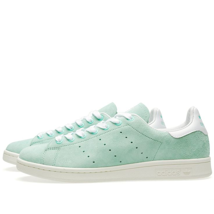 Simple yet so instantly recognisable, the Adidas Stan Smith is one of the brand most heralded designs. Originally named the 'Haillet', the shoe was later endorsed by American tennis player Stan Smith in 1971. Distinctive for two reasons; the perforated three stripes and Smith's illustrated portrait to the tongue; the shoe is constructed with suede uppers, finished with a branded midsole and trefoil heel tab with 'Stan Smith' decal.  SuedeUppers Perforated Three Stripe Branding Trefoil…