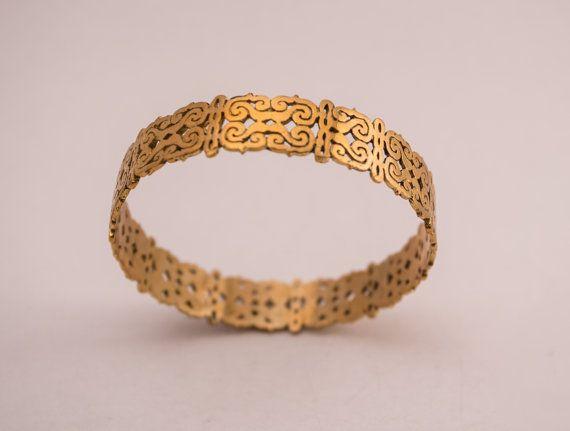 MAIA  tribal brass bangle at https://www.etsy.com/listing/216915477/maia-tribal-bangle-in-yellow-brass