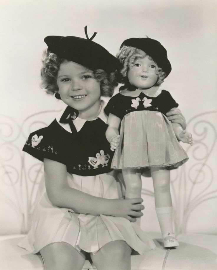 "Shirley Temple in film, ""Curly Top"" with replica doll to match. Costumes, photos and more to be featured in countrywide exhibits before being auctioned by Theriault's on July 14, 2015. https://www.theriaults.com/love-shirley-temple-events-auction-schedule"