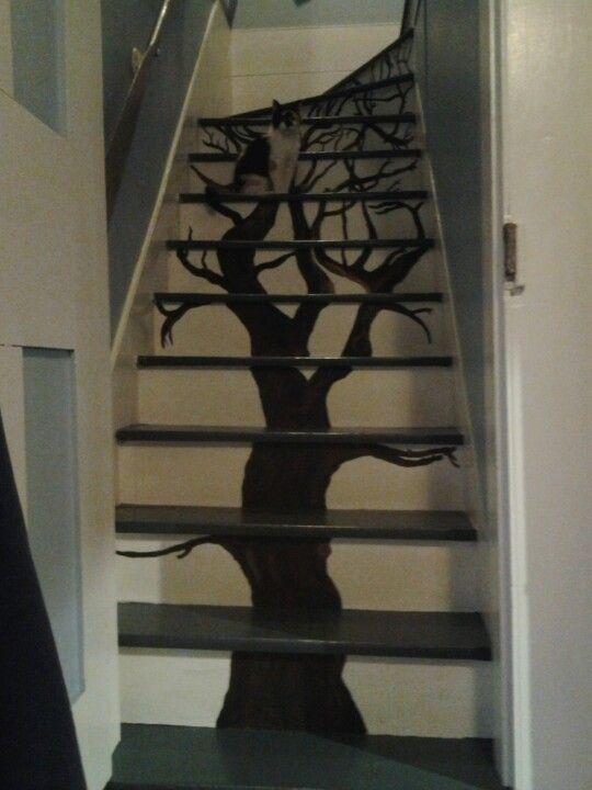 Painted tree on stairway.