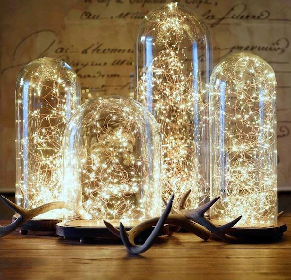 #DIY lighting #idea using bell jars of varying sizes and #string lights. How cool is this?: