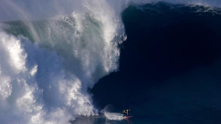 A surfer rides a big wave at the Praia do Norte in Nazare, Portugal. The beach has become a famous spot for big waves surfers around the world after Hawaiian surfer Garrett McNamara set a world record for the largest wave surfed in 2011. (AP Photo/Francisco Seco)