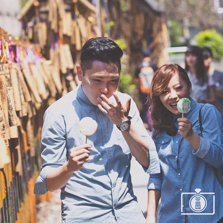 Michael and Jane enjoying ice cool popsicles in the streets of #Taiwan. Photo by Omelett3 Studio. View all #prewedding photos here http://ht.ly/TPoAB #datesnap // www.onethreeonefour.com // #prewedding #wedding #engagement #elopement #photography #couple