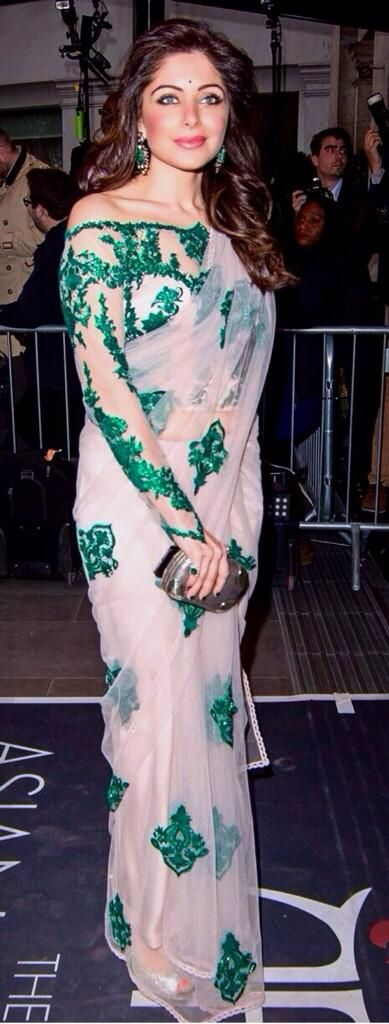 Colours! Kanika Kapoor. Stunning Saree... Does anyone know who the designer is?