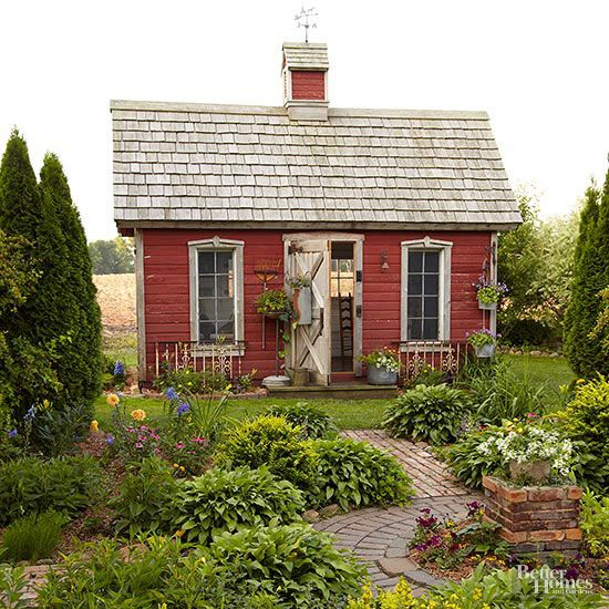 Salvaged windows and barn-board siding give a garden shed instant character. Thoughtful details, like the vintage window trim on the exterior and the cupola perched on the roof, transform what could be a basic storage shed into an inspiring garden-side retreat./