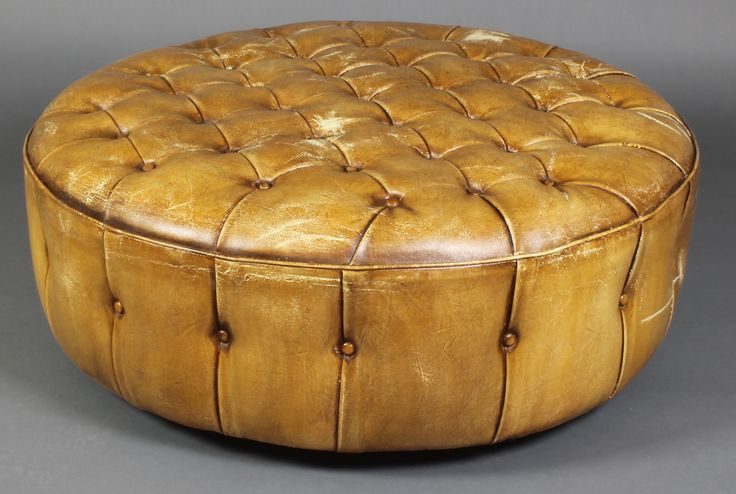 """Lot 878, A circular footstool upholstered in buttoned tan leather 12""""h x 36""""diam., est  £140 - 180"""