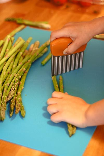 A wavy knife or vegetable chopper is a great way to get toddlers involved in food preparation!