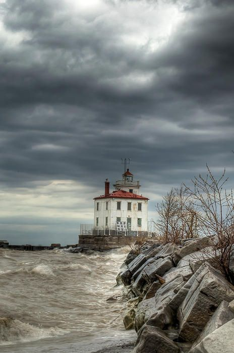 The lighthouse at Headlands Beach State Park on Lake Erie. I was hoping the clouds would lift. For a moment there was break in the clouds and the lighthouse was lit up just alittle bit.