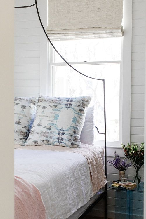 Bedroom with shiplap walls and iron bed. Romantic European Farmhouse Bedroom Decor Ideas!
