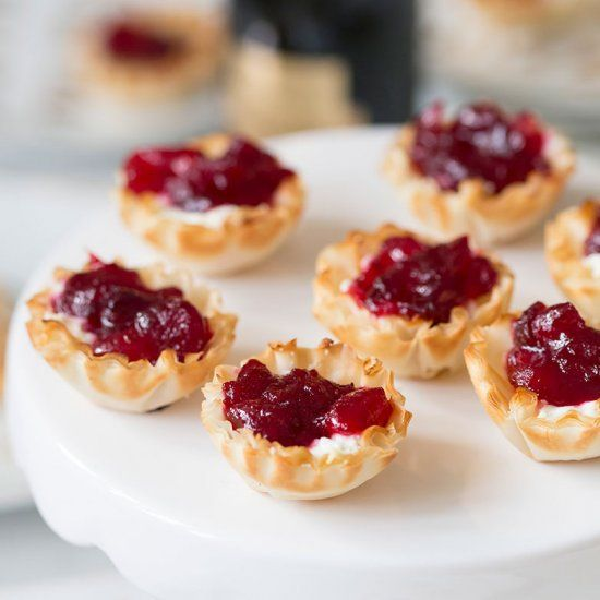 These Bourbon-Infused Cranberry & Goat Cheese Bites are the perfect addition to any party menu!