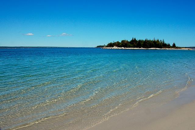 Carter's Beach, Nova Scotia. That shade of blue makes it hard to believe it's a beach in Canada, eh? ;-)