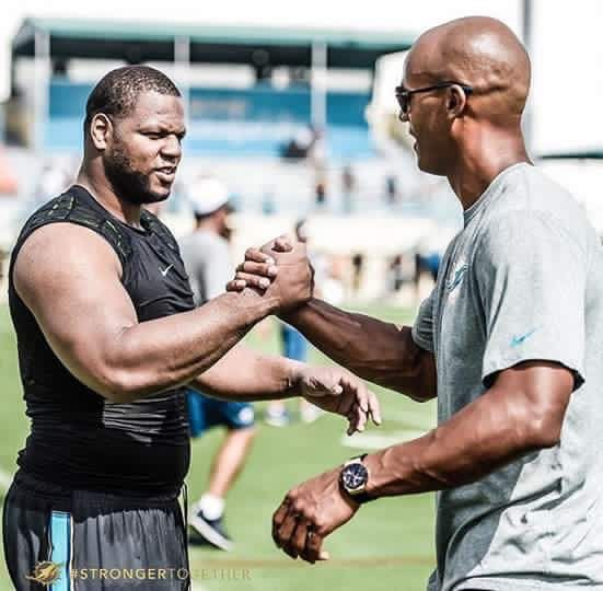 Ndamukong Suh and Jason Taylor