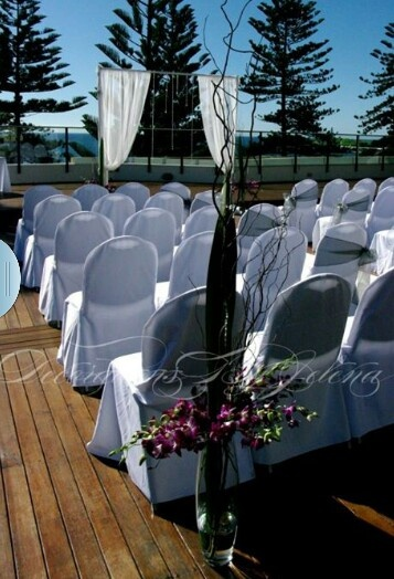 A gorgeous beach side wedding ceremony with purple orchids and crystals <3 and no sand between the toes