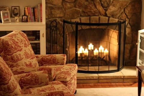 """""""If you have a fireplace, place candles inside instead of lighting a fire. The effect is unexpected, cozy and beautiful.""""   http://tiaandtameraofficial.com/"""