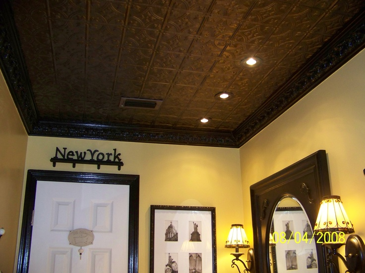 A View Of The Chocolate Tin Ceiling And Black Crown