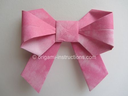 Origami Bow - English directions.  Actually not very hard.  I wanna put one on a present :)