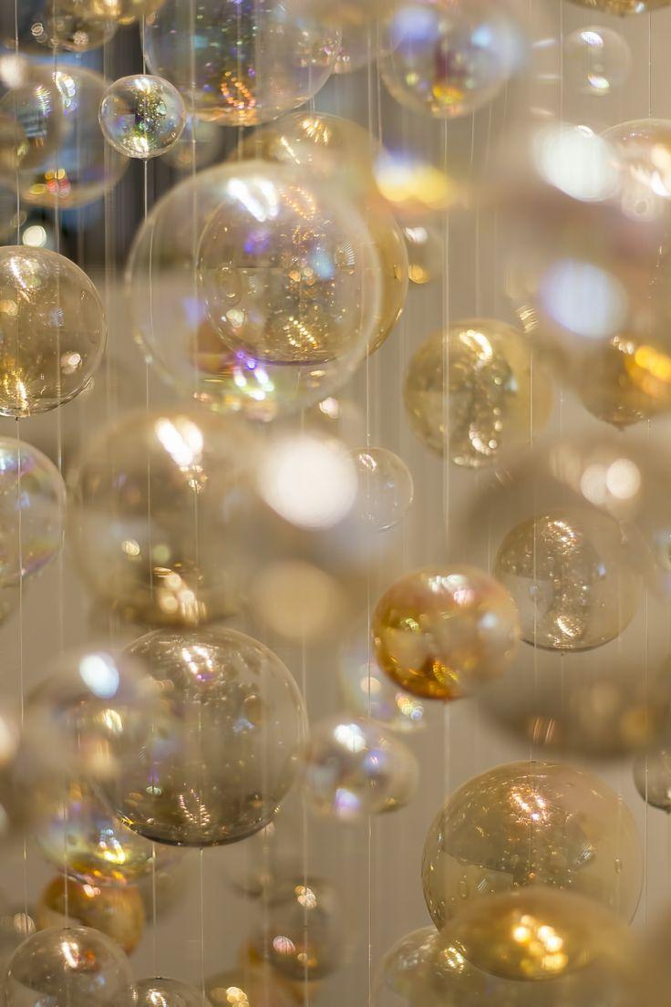 Modern chandelier made of hand blown glass hanging on sparkling fiber optics. Detail.