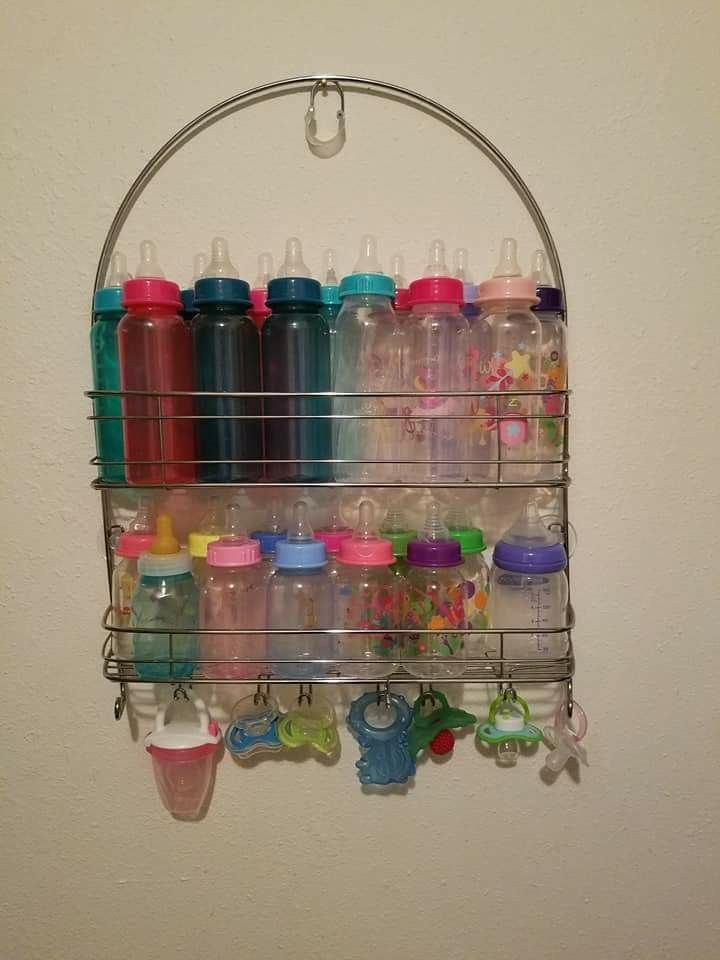 Bottle holder out of an shower caddy. Saves space and you know where everything is.