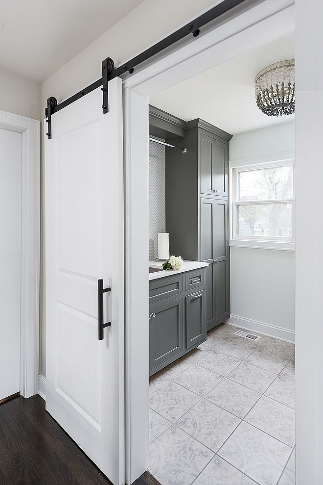 Grey Laundry Room Renovated Laundry Room Upstairs You Will Find A Newly Renovated Laundry Room With Sli Grey Laundry Rooms Laundry Room Doors Bathrooms Remodel
