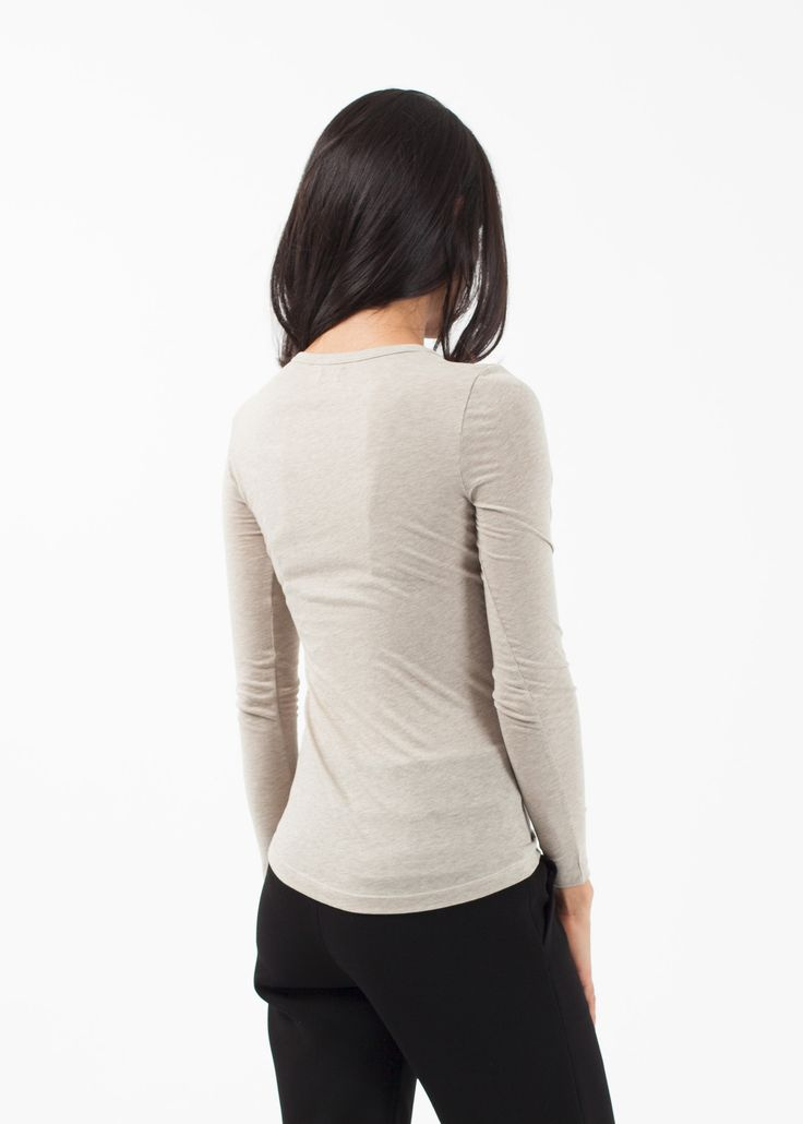 The Long Sleeved Tee is slim fitting and lightweight. Seasonless by nature, the highly versatile top is layer-able for all weather. Wide crew neckline. Colors available; White, Black, Beige. 100% Organic Cotton. Made in Peru. Ashley is wearing an X-Small.