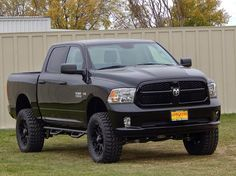 2014 Ram 1500 Express Crew Cab 4X4 with lift kit, custom tires and wheels and steps. #truckaccessories #liftkit