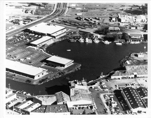Aerial view, looking east, of the Golden Eagle Shopping Center, Washington Street and Petaluma River turning basin