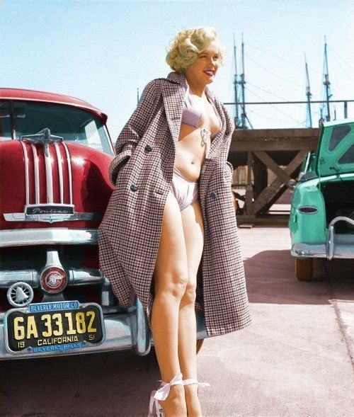 This is a1951 picture of Marilyn Monroe, photographed by Earl Theisen. She is in front of one of her Pontiacs.