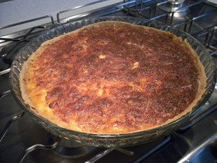 Quiche Lorraine: Quiche Lorraine is a recipe that is both simple and delicious. This savoury tart combines bacon and grated cheese with an egg and cream filling in a short-crust pastry case.