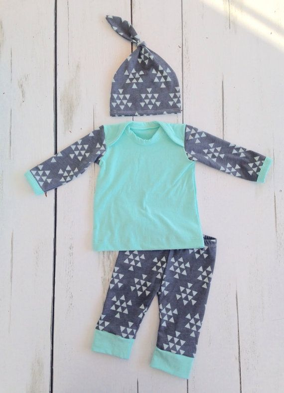 Newborn boy outfit, perfect to take your baby home in! This set comes with a matching shirt, pants, and knot hat. Made with cotton jersey knit.