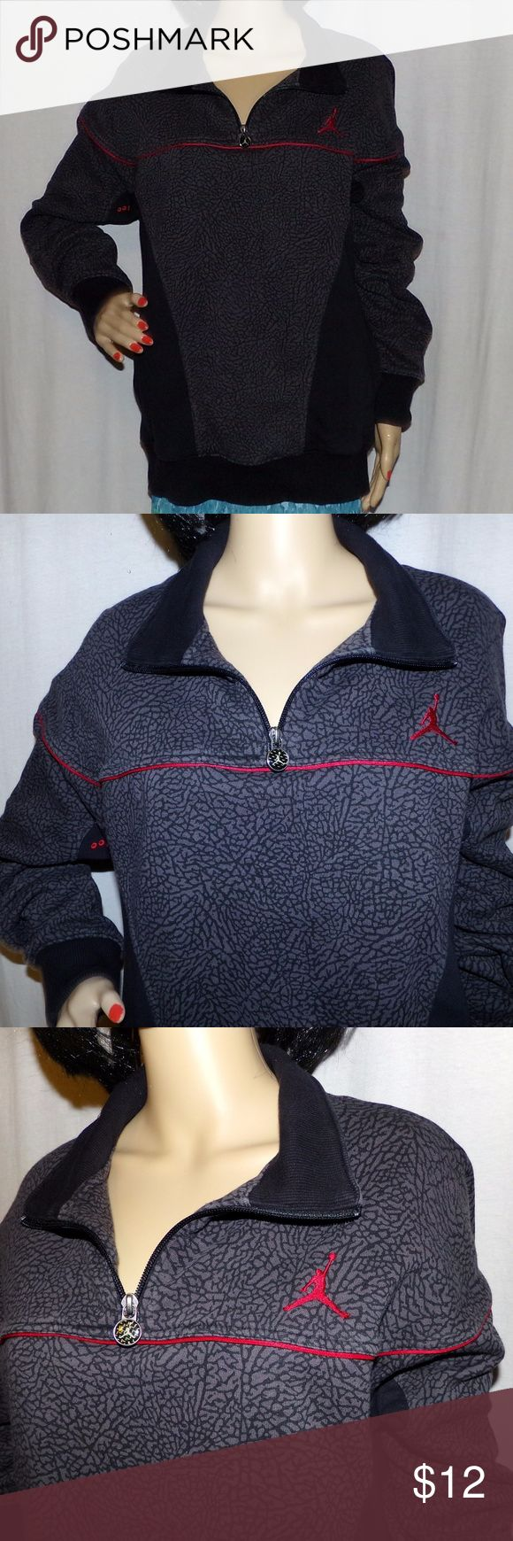 """Michael Jordan Pullover Shirt, Stylish Michael Jordan Pullover Shirt, Stylish with the Jumping Jordan Logo Embroidered Zips size L Low & Fast Shipping, Stylish with the Jumping Jordan Logo Embroidered on it. It is a cool gray and black pattern with red pinstripes and the red logo!  This looks nearly in nearly new condition. Measurements L-20""""/W-40-41. Model's Measurements 32-24-33 BUNDLE & SAVE More or make us an OFFER the Fairies here love OFFERS Jordan Shirts Polos"""