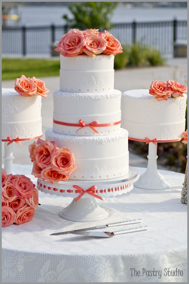 A beautiful cake detailed with a lace wrap. Even though I'm not a fan of the color, this cake is really pretty. Those are also some gorgeous peach garden roses!