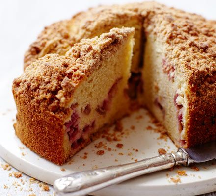 Rhubarb Cake. Pretty-in-pink fruit ripples through this light sponge cake with crunchy crumble topping - a spin on classic comfort baking