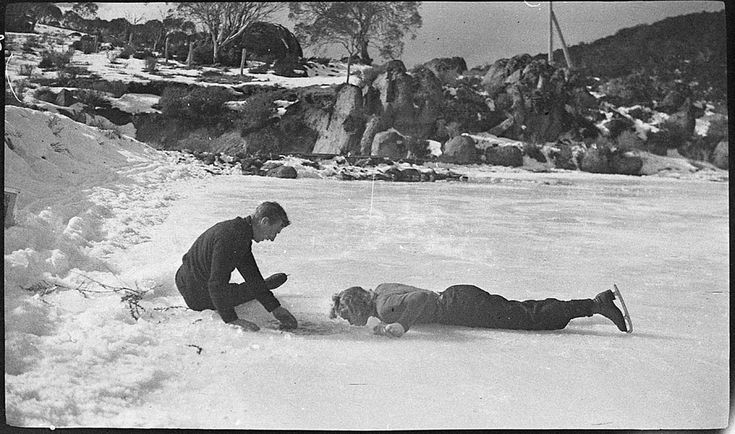Skaters drinking water from a hole cut in the ice, near Mount Koscuisko, c. 1926, by Albert James Perier