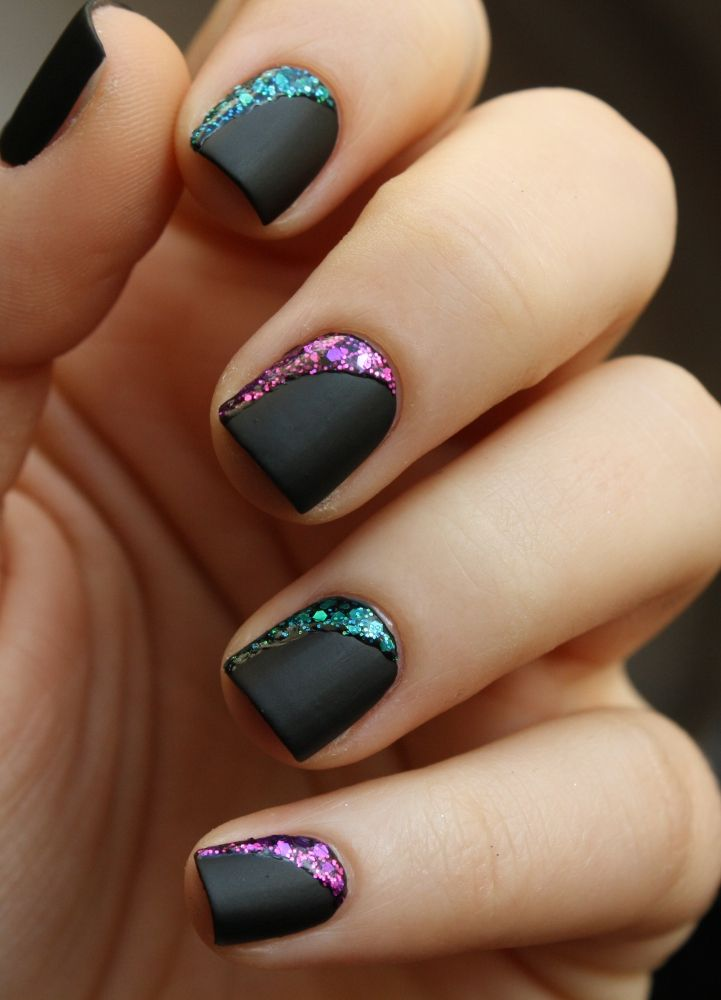 Matte black nails with pretty glitter accents