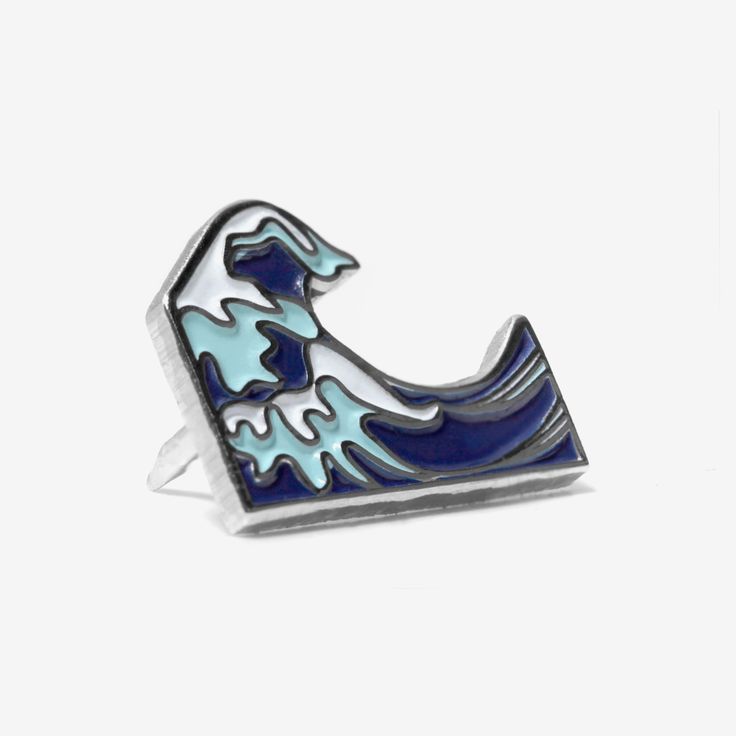 Metal pin with silver finish. Blue and white enamel depict a crashing wave. Stampd logo embossed on back.