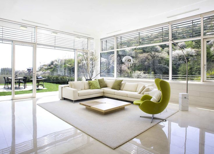 Open Style Modern White Living Room Design with L Shaped White Sofa Furniture and Lime Green Lounge Chair Design also Beautiful White Tiles Color Scheme for Stunning Living Room Design with Modern Furniture