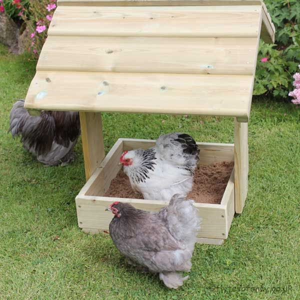Chicken Dustbath & Feeder Shelter. Just fill the base with sand or dry earth and your chickens will love it (and it will save the flowerbeds).