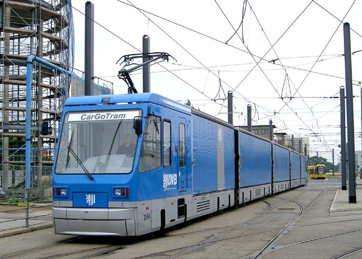Germany - There is no reason why freight cannot travel on urban transport rail systems - this image comes from Dresden in Germany and shows the CarGoTram - seen whilst stationary, waiting for a passenger tram to clear the tramstop immediately in front of it (which is next to the main railway station)