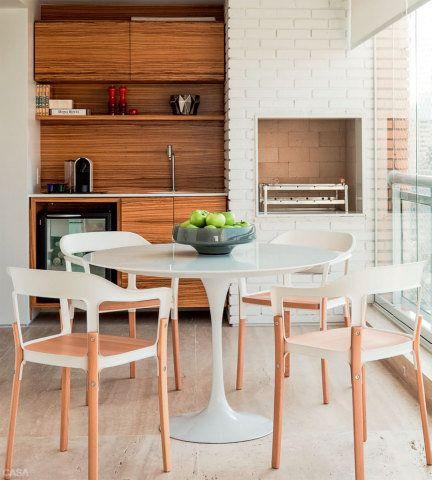 Integração completa da varanda e da sala garante o conforto da família