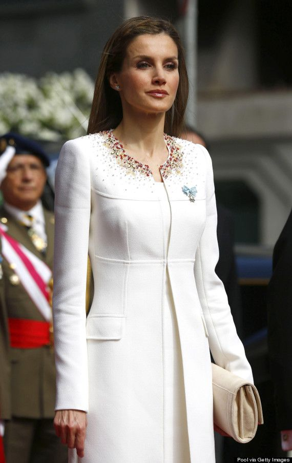 The ensemble was designed by Queen Letizia's favorite Madrid designer, Felipe Varela. Love: the trim cut of the coat and the delicate detailing along the neckline that just so happens to match the colors of the Spanish flag.