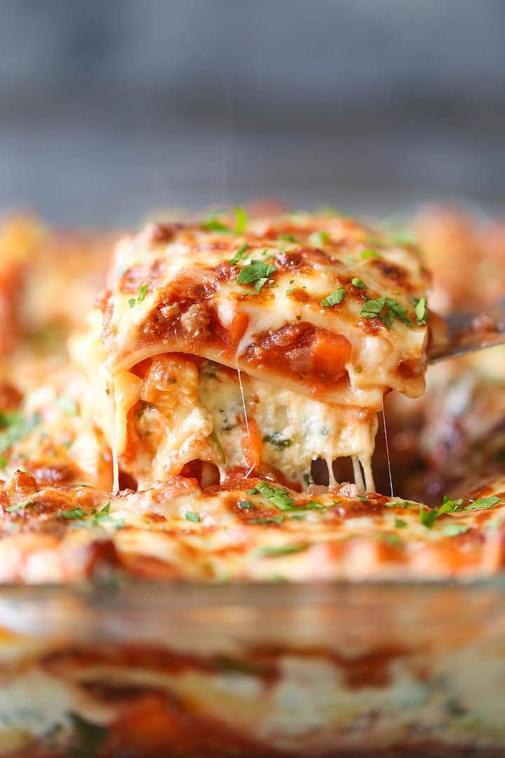 Turkey and Spinach Veggie Lasagna. Lightened-up, skinny lasagna with ground turkey and plenty of vegetables – carrots, onion, zucchini and spinach!