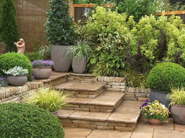 Stone Steps: Broad stone steps built into a corner of a patio turn a walkway into a spot with room for container plants. From HGTV.com's Garden Galleries