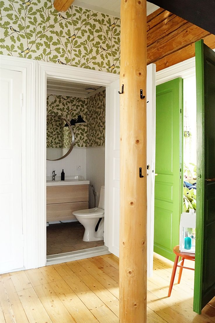 Our renovated toilet and hallway. So lovely view!  toilet, renovation, old house, Sandberg Waldemar wallpaper, Pukkila Hexawood tiles, Ikea Godmorgon, Ikea Stocholm mirror, Clas Ohlson Industry lights, panel wall, hallway, double doors, green doors, timber wall, old board floor,
